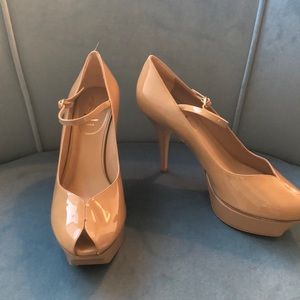 Yves Saint Laurent tulip toe pumps